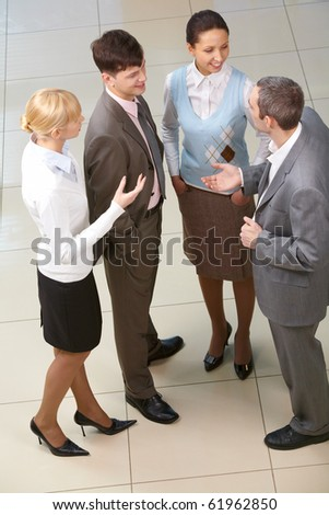 Four business people interacting - stock photo