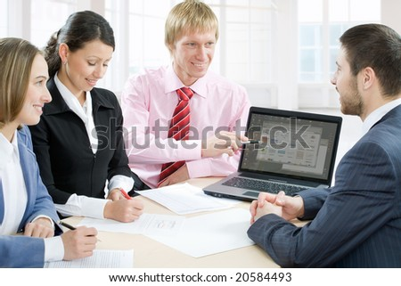 Four business people work - stock photo