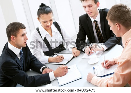 Four business people working together at office