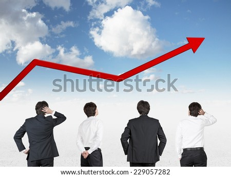 Four businessman are looking at the arrow's fluctuation - stock photo