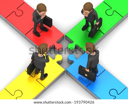 Four businessman thinking over a puzzle - stock photo
