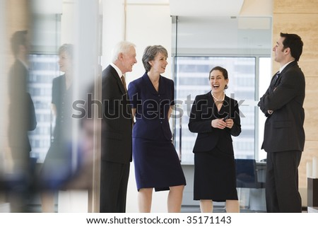Four businesspeople conversing - stock photo