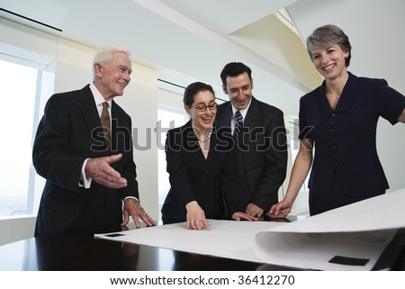 Four businesspeople discussing successful plan