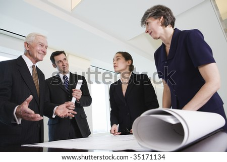 Four businesspeople meeting. - stock photo