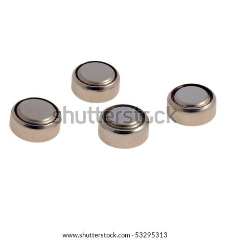 Four button cell batteries against a white background - stock photo
