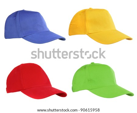 Four caps isolated on white. Blue, yellow, red and green. - stock photo