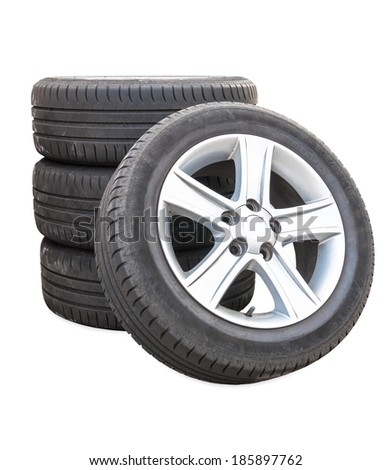 Four car tires isolated on white background with clipping path