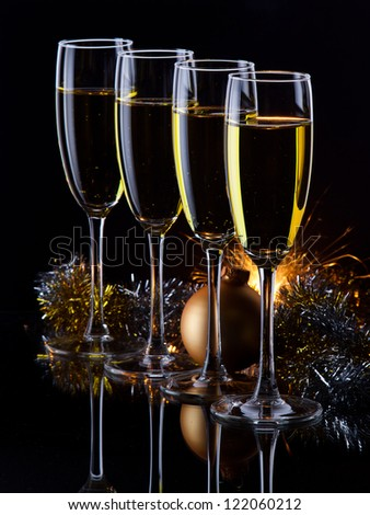 four champagne glasses ready to bring in the New Year - stock photo