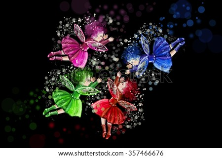 Four Christmas fairies positioned in a circle on a black background. Red, green, blue and purple fairy. Fairy tale characters - stock photo