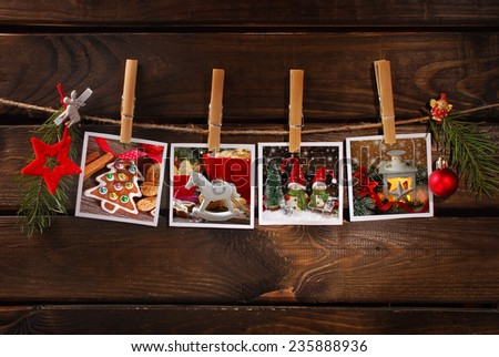 four christmas  photos hanging on rope with bamboo clothespins against old wooden background - stock photo