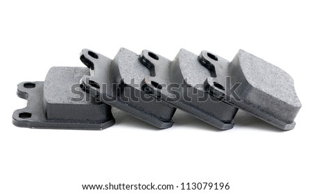 Four clean isolated disc brake pads. Isolate on white. - stock photo