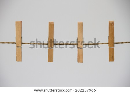 Four clothespin on the rope - stock photo