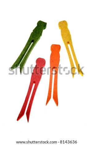 Four clothespins over white - stock photo