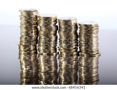 Four coin piles with reflection - stock photo