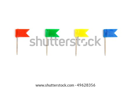 Four color pins isolated on white background