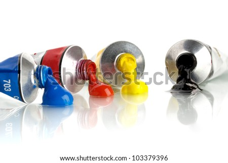 four color, tin tubes squeezed - stock photo