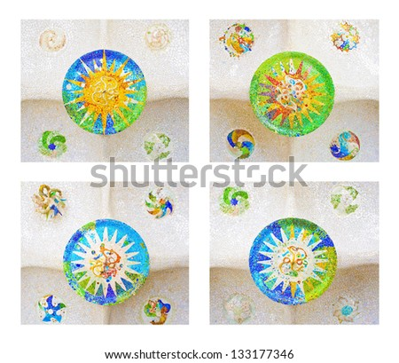 Four colorful tile mosaics on the ceiling of the Hypostyle hall in Parc Guell designed by Antoni Gaudi, Barcelona, Spain. - stock photo