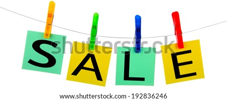 four colour cards hang on clothespins is isolated on a white background - stock photo