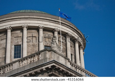four courts dome with EU flag on blue sky, Dublin