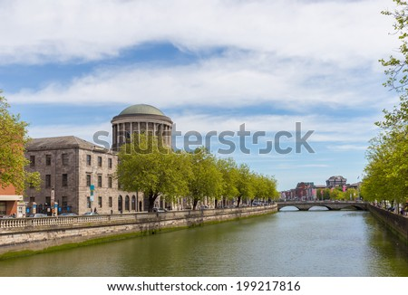 Four Courts with trees at Inns Quay in Dublin city centre - stock photo