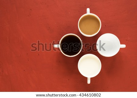 Four cups with milk and coffee