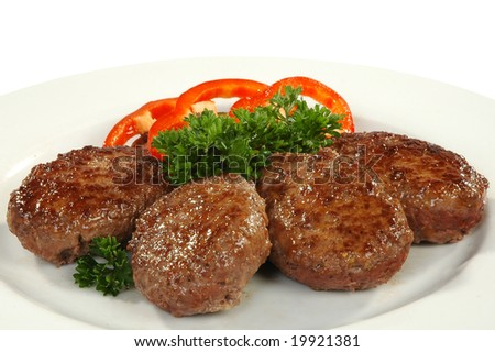 four cutlets with sweet pepper - stock photo