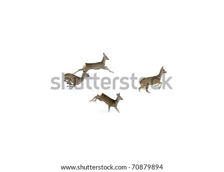 Four deers running on snow - stock photo