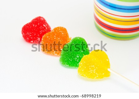 four different color jelly beans over white background