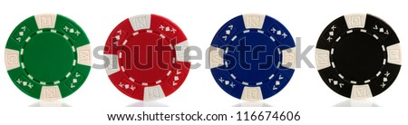 four different coloured poker chips - stock photo