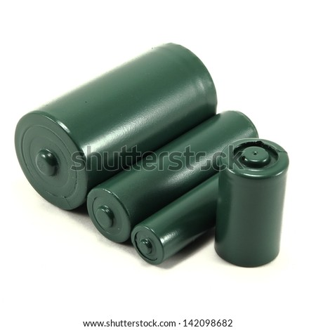 Four different sized green batteries on white background
