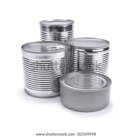 Four different tin cans isolated on white. - stock photo
