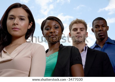 four diverse members looking at camera