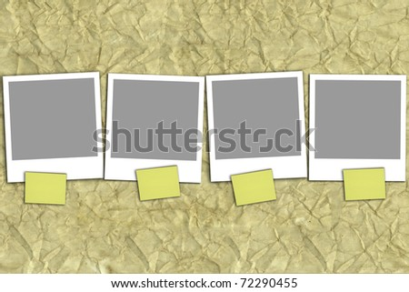 Four empty photographs on recycled paper - stock photo