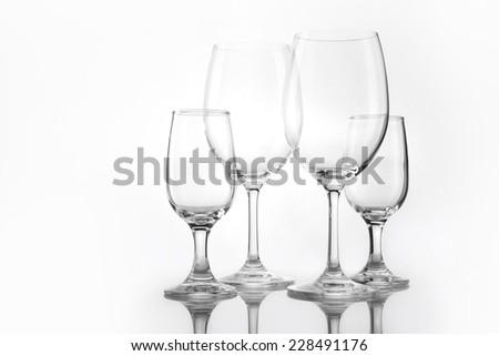 Four empty wine glasses overlapped isolated white. - stock photo