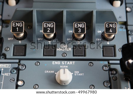 four engine start controls in the cockpit - stock photo