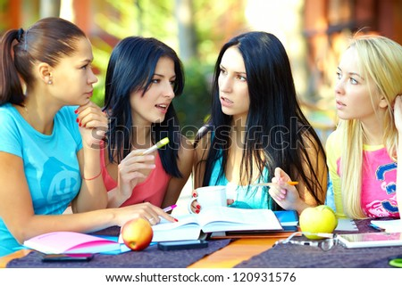 four female student studying for the exam, outdoors - stock photo