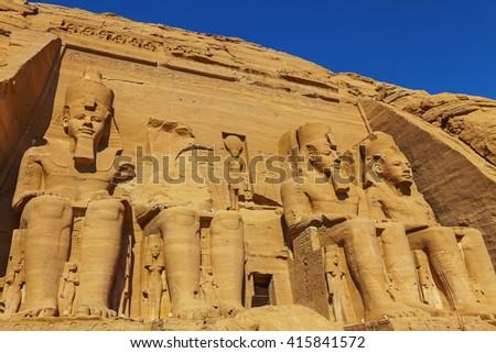 four figures Abu Simbel - stock photo
