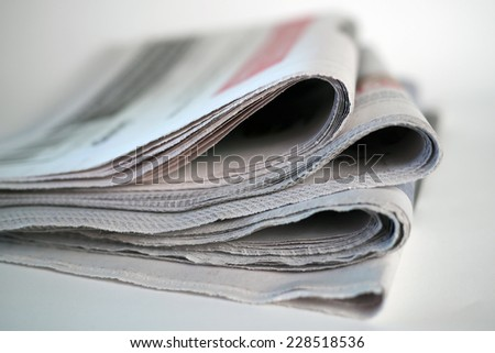 four folded newspapers - stock photo