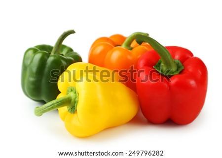 Four fresh pepper isolated on white - stock photo