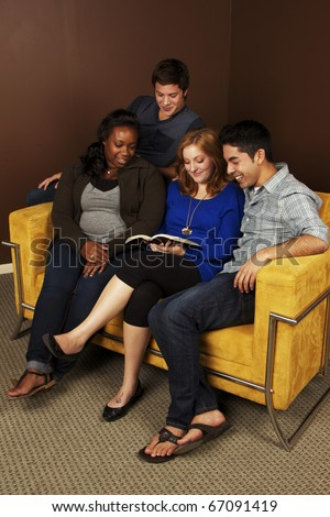 Four Friends Reading the Bible - stock photo