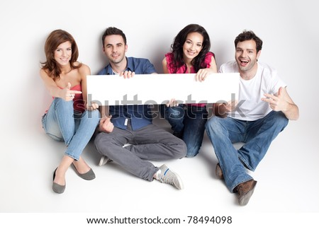 four friends showing a white board - stock photo