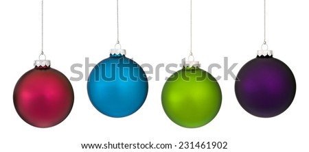 Four frosted glass Christmas ornament hanging from a silver chains against a white background. - stock photo