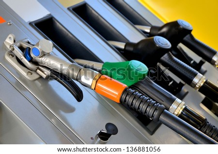 Four Gas nozzles close up - stock photo