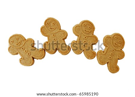 Four gingerbread men cookies on a white background
