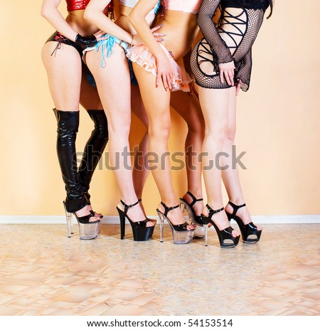 four girls, feet - stock photo