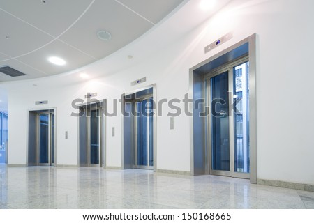 Four glass elevator door in the business building