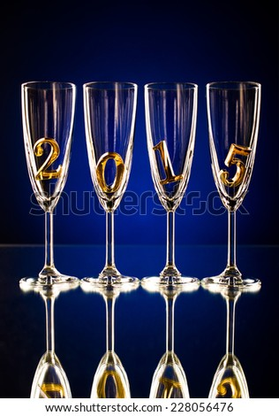 four glass goblet for champagne with  numeral 2015,  beautiful celebrations  New Year concept photo - stock photo