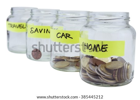 Four glass jars with coins on white background