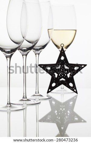 Four  glasses  of  wine and Christmas decoration on the white background - stock photo
