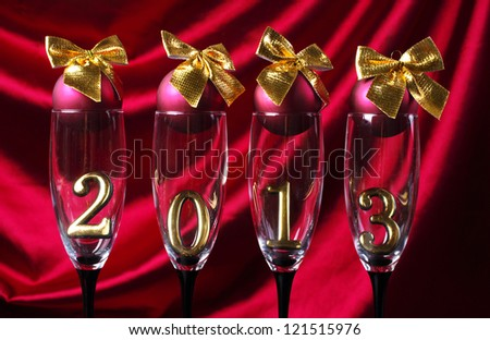 Four  goblets of champagne with numeral 2013 against purple drapery. Happy New Year! - stock photo